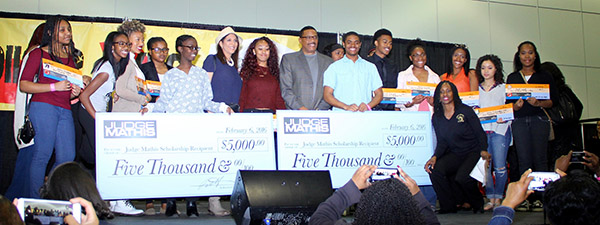 Students smile as Judge Mathis and the National College Resources Foundations give out scholarships. (Courtesy Photo)