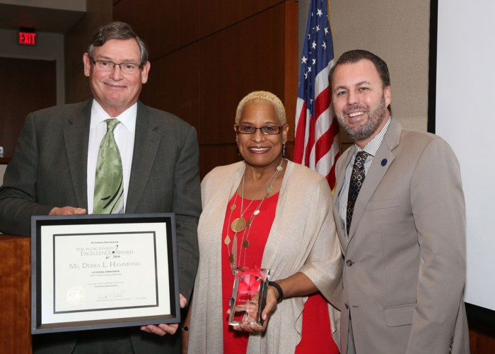 From left, CSU Chancellor Timothy White, Debra Hammond and CSU Board of Trustees Chair Lou Manville shortly after Hammond was presented with her award at a CSU board meeting in Long Beach. Photo courtesy of the CSU Chancellor's Office. (courtesy photo)