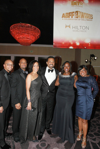 Hilton Worldwide executives, Courtney Eison (Multicultural Sales), senior manager, Melanie Melson and guest, ABFF Awards host, actor, Mike Epps, Andrea Richardson (Resorts and Multicultural marketing) and Sonya Toliver Irby (Luxury Brand Sales) during the ABFF Awards: Celebration of Hollywood ceremony pre-reception. (Pictured L to R)(Photo Credit: Soul Brother)
