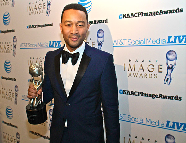 Singer John Legend holds his NAACP President's Award for his work and philanthropy. (Mesiyah McGinnis/LA Sentinel)