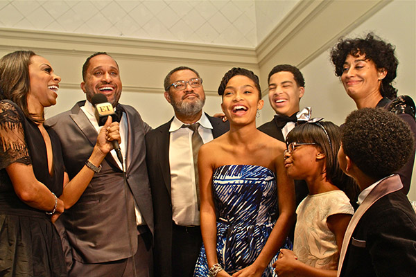 "Entertainment Tonight's Nichelle Turner interviews the cast and producer of ABC'S ""Black-ish"". Cast members (l-r) Laurence Fishburne, Marcus Scribner, Tracee Ellis Ross, Yara Shahidi, Marsai Martin and Miles Brown. (Mesiyah McGinnis/LA Sentinel)"