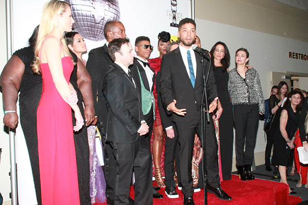 "Jussie Smollett speaks with the cast and producers of ""Empire"" after accepting their award for outstanding drama series. (Mesiyah McGinnis/LA Sentinel)"