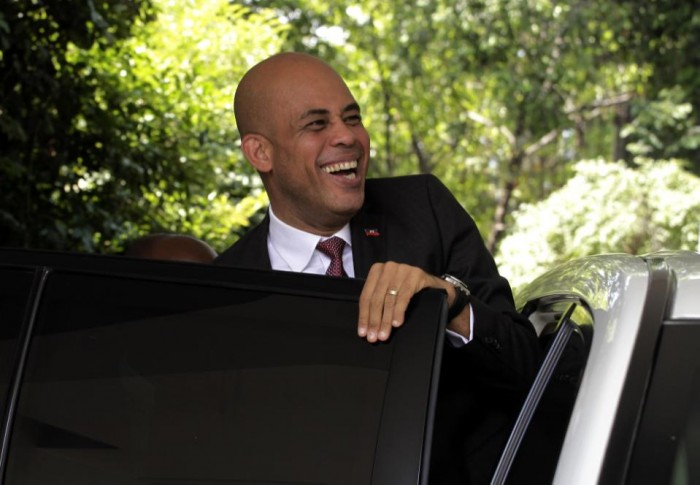 In this May 5, 2011 photo, Haiti's President-elect Michel Martelly leaves after a press conference in Port-au-Prince, Haiti. Martelly came to office promising a stronger Haiti following a messy election that provoked widespread skepticism. He is due to leave power Sunday, Feb. 7, 2016 at the close of his five-year term with few accomplishments and a legacy clouded by a new political crisis.  (AP Photo/Brennan Linsley, File)