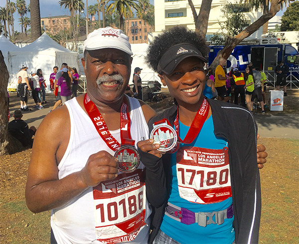 Van Hutchins (left) and Latasha Lyons (right) pose with their LA Marathon medals (Courtesy of Latasha Lyons)