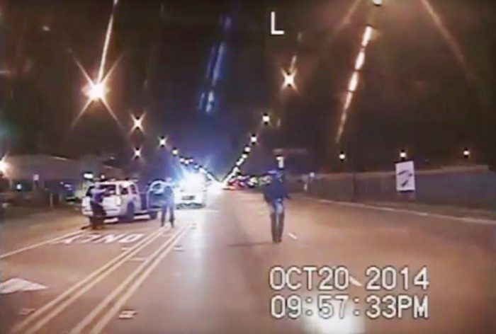 "In this Oct. 20, 2014, file frame grab from dash-cam video provided by the Chicago Police Department, Laquan McDonald, right, walks down the street moments before being shot by officer Jason Van Dyke 16 times in Chicago. For more than a year after Van Dyke killed McDonald, the Chicago Police Department had video footage and autopsy results that raised serious questions about whether other officers on the scene tried in their reports to cover up what prosecutors now contend was murder. The lack of swift action against the officers illustrates the difficulty of confronting the ""code of silence"" that has long been associated with police in Chicago and elsewhere. (Chicago Police Department via AP, File)"