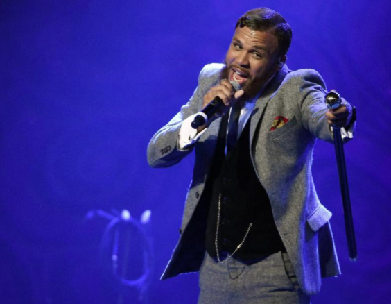 "In this Dec. 2, 2015 file photo, Jidenna performs during EBONY magazine's 30th Annual Power 100 Gala in Beverly Hills, Calif. Jidenna, who is putting the final touches on his debut album, is nominated for a Grammy for best rap/sung collaboration for his ""Classic Man"" single, which features Roman GianArthur. (Photo by Chris Pizzello/Invision/AP, File)"