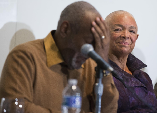 Camille Cosby, right, looks on as Bill Cosby speaks during a news conference about the upcoming exhibit, Conversations: African and African-American Artworks in Dialogue at the Smithsonian's National Museum of African Art, in Washington on Nov. 6, 2014. (AP Photo/Evan Vucci)