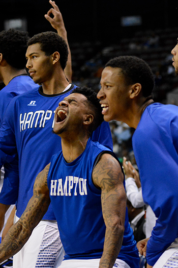 Hampton U players celebrate as they beat South Carolina State in the 2016 MEAC Championship game, earning a 2nd consecutive big in the NCAA March Madness Tournament.    (Photo courtesy of Hampton University Marketing Department)