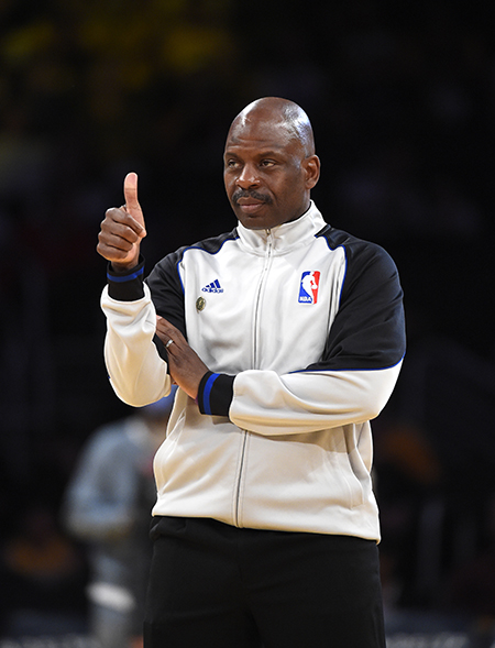 Referee Derek Richardson gestures prior to an NBA basketball game between the Los Angeles Lakers and the Memphis Grizzlies, Sunday, April 13, 2014, in Los Angeles.  (AP Photo/Mark J. Terrill)