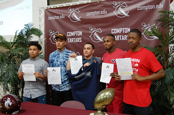 Compton College students pose during their signing day ceremony (courtesy of Steven Mojarro)