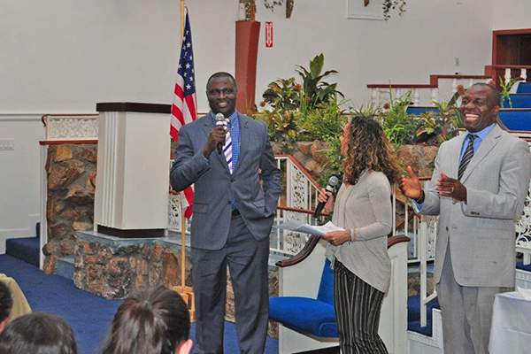 Dr. Yaw Adutwum addresses students during a school wide assembly. (courtesy of New Designs Charter School)