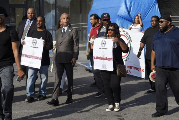 Rev. Al Sharpton, center, leads a rally prior to the Academy Awards ceremony, Sunday, Feb. 28, 2016, in the Hollywood section of Los Angeles in support of the nationwide TV tune-out protesting the lack of diversity in Hollywood. (AP Photo/Mark J. Terrill)