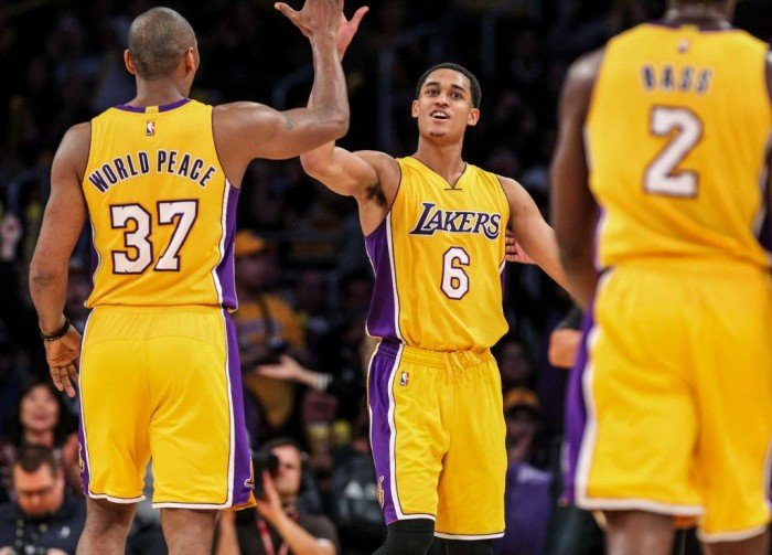 Los Angeles Lakers forward Metta World Peace, left, celebrates with Jordan Clarkson, center, during a timeout in the second half of an NBA basketball game against the Orlando Magic Tuesday, March 8, 2016, in Los Angeles. The Lakers won 107-98. (Ringo H.W. Chiu, AP)