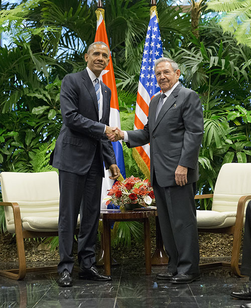 President Barack Obama shakes hands with with Cuban President Raul Castro during their meeting at the Palace of the Revolution, Monday, March 21, in Havana, Cuba. (AP Photo/Pablo Martinez Monsivais)
