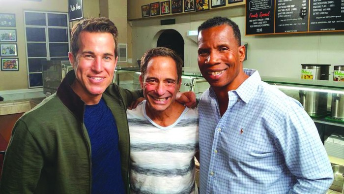"""""""South Of Wilshire"""" host Adam Glyn, show creator/executive producer Harvey Levin and Greg Dulan, owner of the soul food restaurant, Dulan's."""