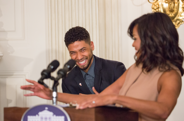 "On Wednesday, February 24, in the State Dining Room of the White House, Jussie Smollett laughs as First Lady Michelle Obama introduces him at the student workshop: ""The Musical Legacy of Ray Charles."" 