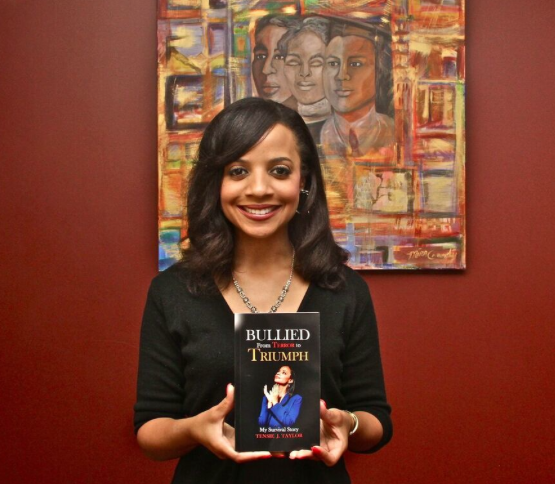 Author Tensie Taylor stands holding her at the USC Black Alumni Association. She hopes her book will create a discussion among the African American community about the effects of bullying (Mesiyah McGinnis/LA Sentinel)