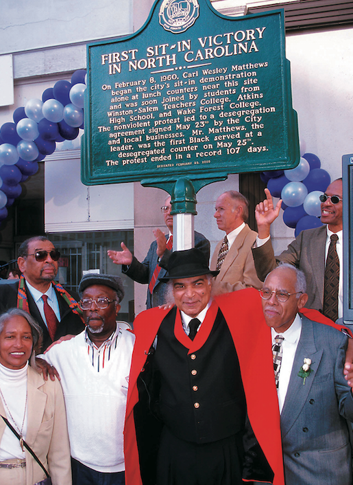 Carl Matthews, center, with other sit-in participants at the state historic marker for the sit-in. Matthew's led the local lunch counter protest in 1960 that became North Carolina's first victory for the sit-in movement. (FILE PHOTO/WSC)