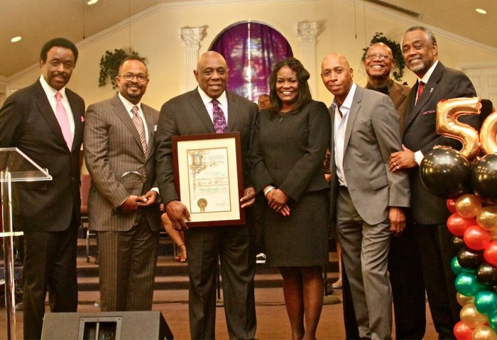 From left are sportscaster Jim Hill, Rodney Phillips of Woody's Barbeque, Pastor R.A. Williams, Michelle King, Jeffrey Osborn, James Smith and L.A. Councilman Curren Price. (photo by E. Mesiyah McGinnis)