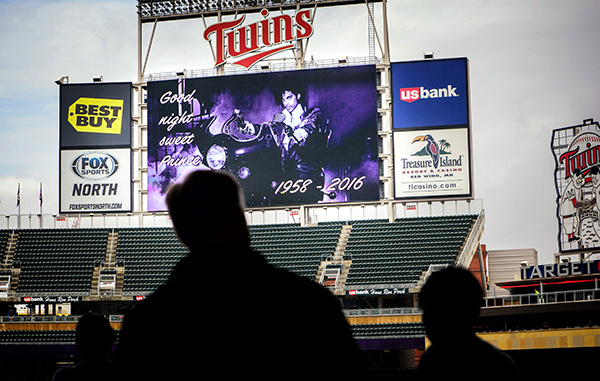 """""""Goodnight Sweet Prince"""" read the display screens in Target Field in Minneapolis, Minn., Thursday, April 26, 2016, following the announcement of Prince's death.  Prince, widely acclaimed as one of the most inventive and influential musicians of his era with hits including """"Little Red Corvette,"""" ''Let's Go Crazy"""" and """"When Doves Cry,"""" was found dead at his home on Thursday, according to his publicist. He was 57.  (Glen Stubbe/Star Tribune via AP)"""