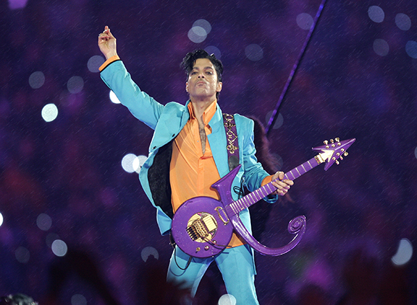 """FILE - In this Feb. 4, 2007 file photo, Prince performs during the halftime show at the Super Bowl XLI football game at Dolphin Stadium in Miami. Prince, widely acclaimed as one of the most inventive and influential musicians of his era with hits including """"Little Red Corvette,"""" ''Let's Go Crazy"""" and """"When Doves Cry,"""" was found dead at his home on Thursday, April 21, 2016, in suburban Minneapolis, according to his publicist. He was 57. (AP Photo/Chris O'Meara, File)"""