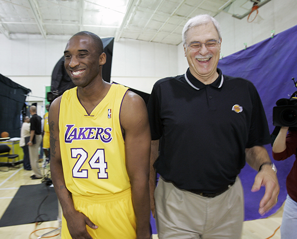 **FILE** Los Angeles Lakers' Kobe Bryant, right, and head coach Phil Jackson share a laugh as they walk to a photo shoot during Lakers media day in El Segundo, Calif., in this file photo from  Oct. 2, 2006. Bryant says he can handle just about any kind of criticism. Calling him a dirty player crosses the line. Bryant reacted angrily to such a concept Wednesday, March 14, 2007, and expressed gratitude for the support given him by Los Angeles Lakers coach Phil Jackson. (AP Photo/Kevork Djansezian-File)