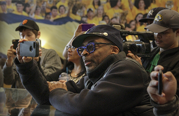 """Director Spike Lee records a Concerned Student 1950 demonstration through the University of Missouri Student Center on campus on Monday, March 7, 2016, in Columbia, Mo. The MU football team may be the stars of a new ESPN """"30 for 30"""" documentary about the team's involvement in the Concerned Student 1950 movement on campus last fall. (Sarah Bell/Missourian via AP)"""