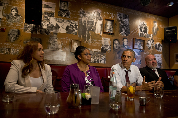 President Barack Obama meets with people who were formerly incarcerated and have previously received commutations, Wednesday, March 30, 2016, at Busboys and Poets restaurant in northwest Washington. From left are, Serena Nunn, Ramona Brant, the president and Phillip Emmert.  (AP Photo/Jacquelyn Martin)