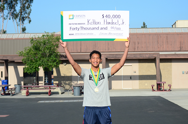 Kelton Hardrict Jr., a senior at Whitney High School in Cerritos, was recently surprised during an assembly with a $40,000 college scholarship in becoming a 2016 Edison Scholar. Hardrict, who plan to study mechanical engineering at the Massachusetts Institute of Technology, is one of 30 high school seniors to be named 2016 Edison Scholars in their pursuit of college studies in science, technology, engineering or math (STEM). Edison International, the parent company of Southern California Edison, awards the 30 scholarships annually. Edison International has awarded more than $5.3 million in scholarships to 520 students since 2006.