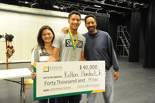 Kelton Hardrict Jr., with his parents, Kelton and Grace, basks in his $40,000 Edison Scholars award.