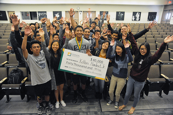 Kelton Hardrict Jr. gets a little help from his Whitney High School friends and classmates in showing off his $40,000 Edison Scholars award. Hardrict plans to pursue his passion for engineering by using his award to earn a mechanical engineering degree at the Massachusetts Institute of Technology in the fall.