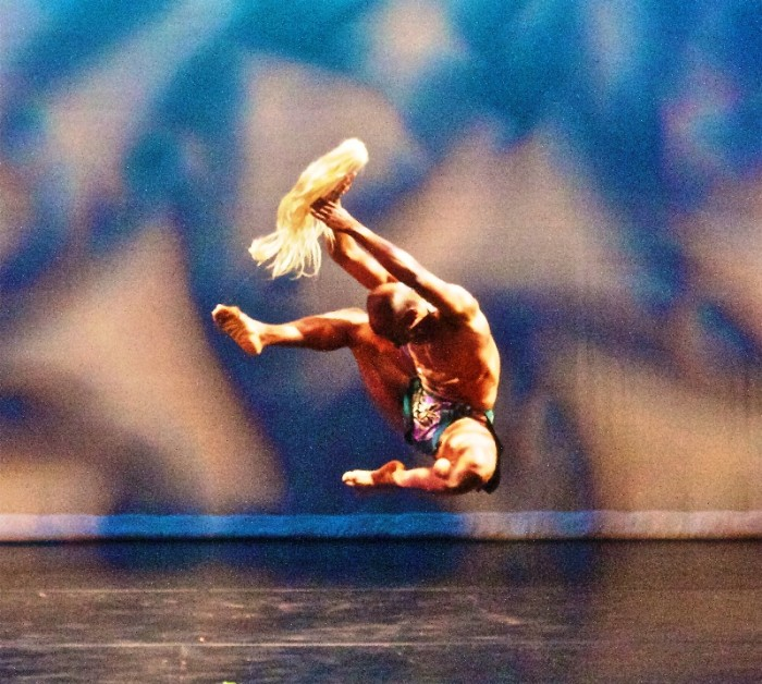 Michael Tomlin III leaps in the air in Global Village choreographed by Lula Washington, was part of a shared concert with Pony Box Dance Theatre on Saturday, April 2, at Nate Holden Performing Arts Center. (Photo by E. Mesiyah McGinnis for the L.A. Sentinel)