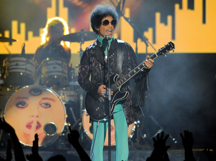 "In this May 19, 2013 file photo, Prince performs at the Billboard Music Awards at the MGM Grand Garden Arena in Las Vegas. Prince, widely acclaimed as one of the most inventive and influential musicians of his era with hits including ""Little Red Corvette,"" ''Let's Go Crazy"" and ""When Doves Cry,"" was found dead at his home on Thursday, April 21, 2016, in suburban Minneapolis, according to his publicist. He was 57. (Photo by Chris Pizzello/Invision/AP, File)"