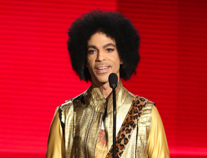 In this Nov. 22, 2015 file photo, Prince presents the award for favorite album - soul/R&B at the American Music Awards in Los Angeles. (Photo by Matt Sayles/Invision/AP, File)