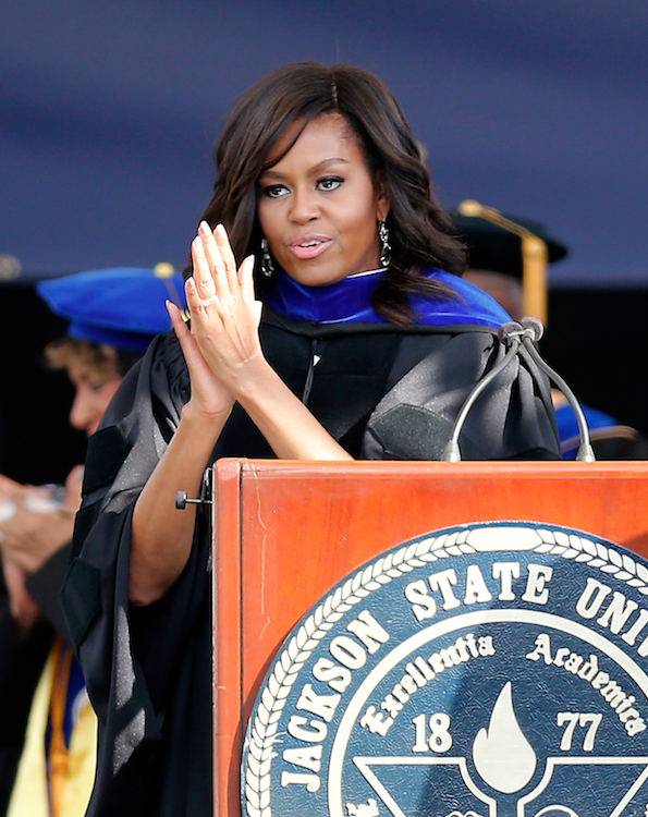First lady Michelle Obama salutes the graduating students as she delivers the commencement address for Jackson State University's Class of 2016 at the Mississippi Veterans Memorial Stadium in Jackson, Miss., Saturday, April 23, 2016. (AP Photo/Rogelio V. Solis)