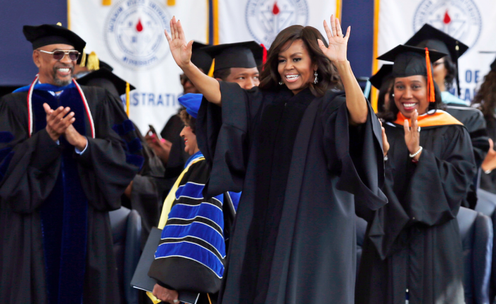First lady Michelle Obama waves at the graduating seniors as she walks to her seat prior to delivering the commencement address for Jackson State University's Class of 2016, at the Mississippi Veterans Memorial Stadium in Jackson, Miss., Saturday, April 23, 2016. (AP Photo/Rogelio V. Solis)