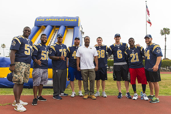 Los Angeles Rams players pose for a photo with Inglewood Mayor James T. Butts during the Los Angeles Rams play 60 event on May 13, 2016 in Inglewood, Calif. (Los Angeles Rams/Ric Tapia)