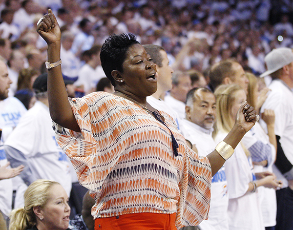 Kevin Durant's mother, Wanda Pratt, dances on the sidelines during Game 2 in the first round of the NBA basketball playoffs, in Oklahoma City, Monday, April 30, 2012. (AP Photo/Sue Ogrocki)