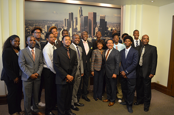 The Crenshaw Boys basketball team poses with council member Marqueece Harris-Dawson and City Council president Herb Wesson. (Amanda Scurlock/ L.A. Sentinel)
