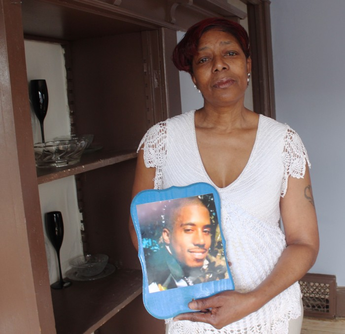 Maria Hamilton holds a photo of her son Dontre Hamilton, who was fatally shot by a Milwaukee police officer in April 2014, at her home on Monday, March 30, 2015 in Milwaukee. Maria has started a support group for mothers of sons killed in police encounters called Mothers for Justice United. The group is organizing a Mlilion Moms March in Washington, D.C. on Mother's Day for mothers in similar situations.  (AP Photo/Carrie Antlfinger)
