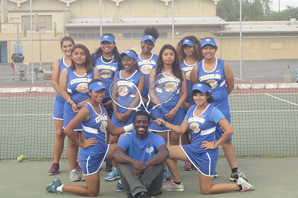 Tennis head coach MarQuis Davis poses with the girls tennis team (Courtesy of MarQuis Davis)