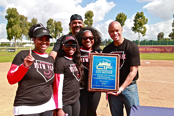 The View Park Prep Knights coaches and administrators celebrate after winning the 2016 CIF LA City Section Girl's Softball Championship, on May 21, 2016 at Cal State Dominguez Toro Field.  Left to right, Aprylle Ross (Asst. Coach), Leesa Harris (Head Coach), Brittnei Price (Asst. Coach), Hurshel Williams (Principal),  back row,  Robert Ambers (Athletic Director). (Staff photographer, E. Mesiyah McGinnis)
