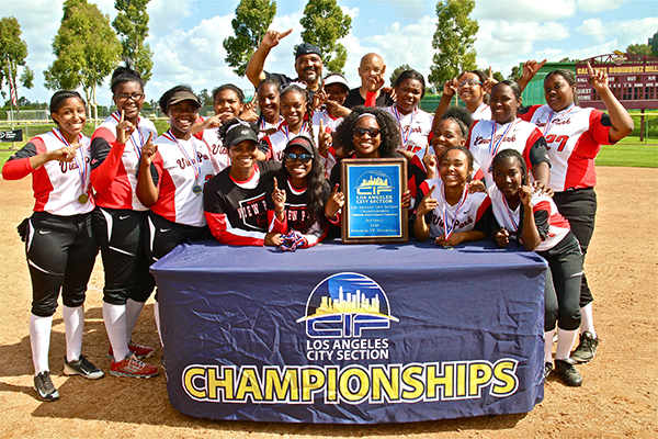 View Park Prep players, coaches, and administrators celebrate after winning the 2016 LA City CIF Section Girl's Softball Championship, in their first year competing in the sport, on Saturday, on May 21, 2016, at Cal State Dominguez Toro Field. (Staff photographer, E. Mesiyah McGinnis)