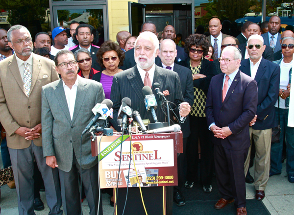 L.A. Councilman Curren Price (l) and L.A. community leaders join Brotherhood Crusade Board Chairman Danny Bakewell Sr., (c) in a show of support for L.A. Council President Herb Wesson (2nd from left ), a victim of hate crimes.