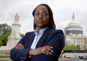In this photo taken May 13, 2016, Mary Tobin, wearing her West Point class ring, poses for picture in Washington, Friday, May 13, 2016. Self-expression is hardly a part of life for cadets at the United States Military Academy at West Point.Tobin, who has mentored other black women cadets since graduating in 2003, said the experience is one rarely discussed publicly. (AP Photo/Manuel Balce Ceneta)