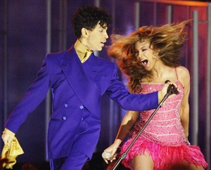 In this Feb. 8, 2004, file photo, Beyonce, right, and Prince perform during the 46th Annual Grammy Awards in Los Angeles.  (AP Photo/Kevork Djansezian, File)