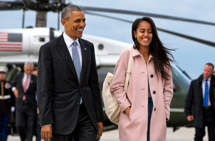 In a Thursday, April 7, 2016 file photo, President Barack Obama jokes with his daughter Malia Obama as they walk to board Air Force One from the Marine One helicopter, as they leave Chicago en route to Los Angeles. T (AP Photo/Jacquelyn Martin, File)
