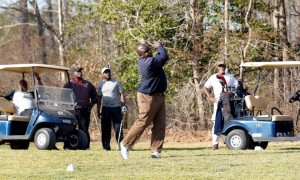 : Chalmers Hinton, center, tees off while his golfing buddies watch at Meadowbrook Country Club in Garner on March 23, 2016. Chris Seward cseward@newsobserver.com