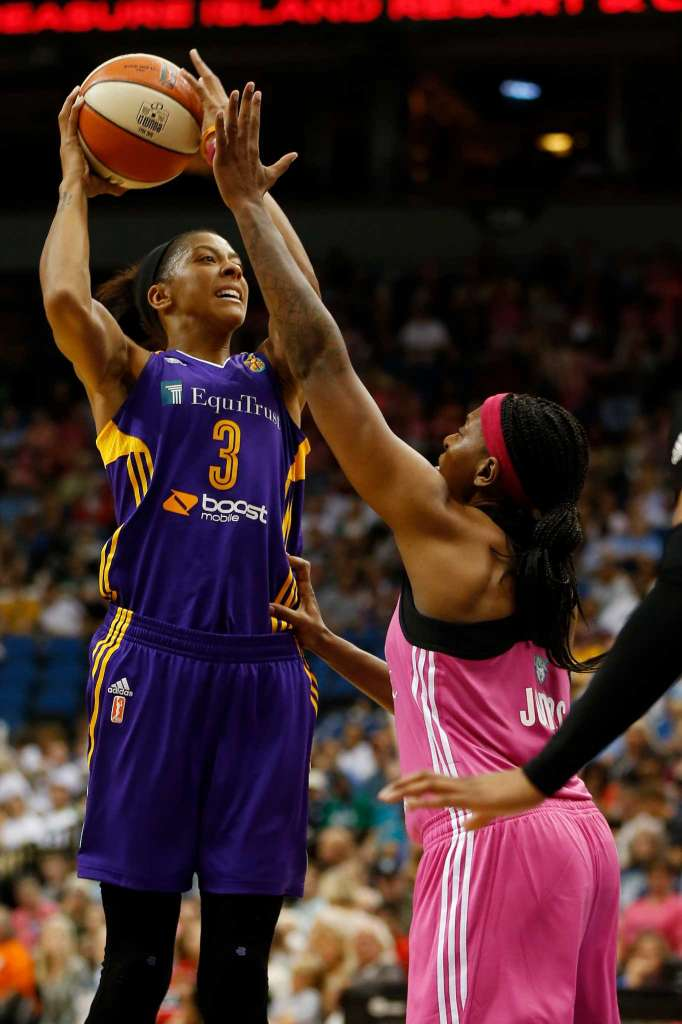 In this Aug. 9, 2015, file photo, Los Angeles Sparks center Candace Parker (3) shoots against Minnesota Lynx forward Asjha Jones during the first half of a WNBA basketball game, in Minneapolis. What a difference a year makes. The Sparks are 3-0 for the first time since 2003 after rallying from an eight-point deficit in the final 80 seconds on Saturday against the New York Liberty to win in overtime. The Sparks didn't win their third game last season until July 21 (Stacy Bengs/AP)
