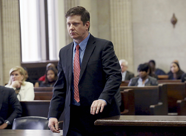 FILE - In this March 23, 2016 file photo, Chicago Police officer Jason Van Dyke, charged with murder in the 2014 videotaped shooting death of black teenager Laquan McDonald, walks in a courtroom during a hearing at the Leighton Criminal Court Building in Chicago. The attorney for Van Dyke has asked for sheriff's deputies to guard the officer as he enters and exits court. The judge could rule on those requests during a hearing Thursday, May 5, 2016. (Nancy Stone/Chicago Tribune via AP, Pool, File)